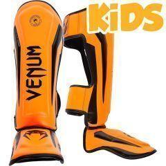 Детские тайские шингарды (накладки на ноги) Venum Elite - black/orange